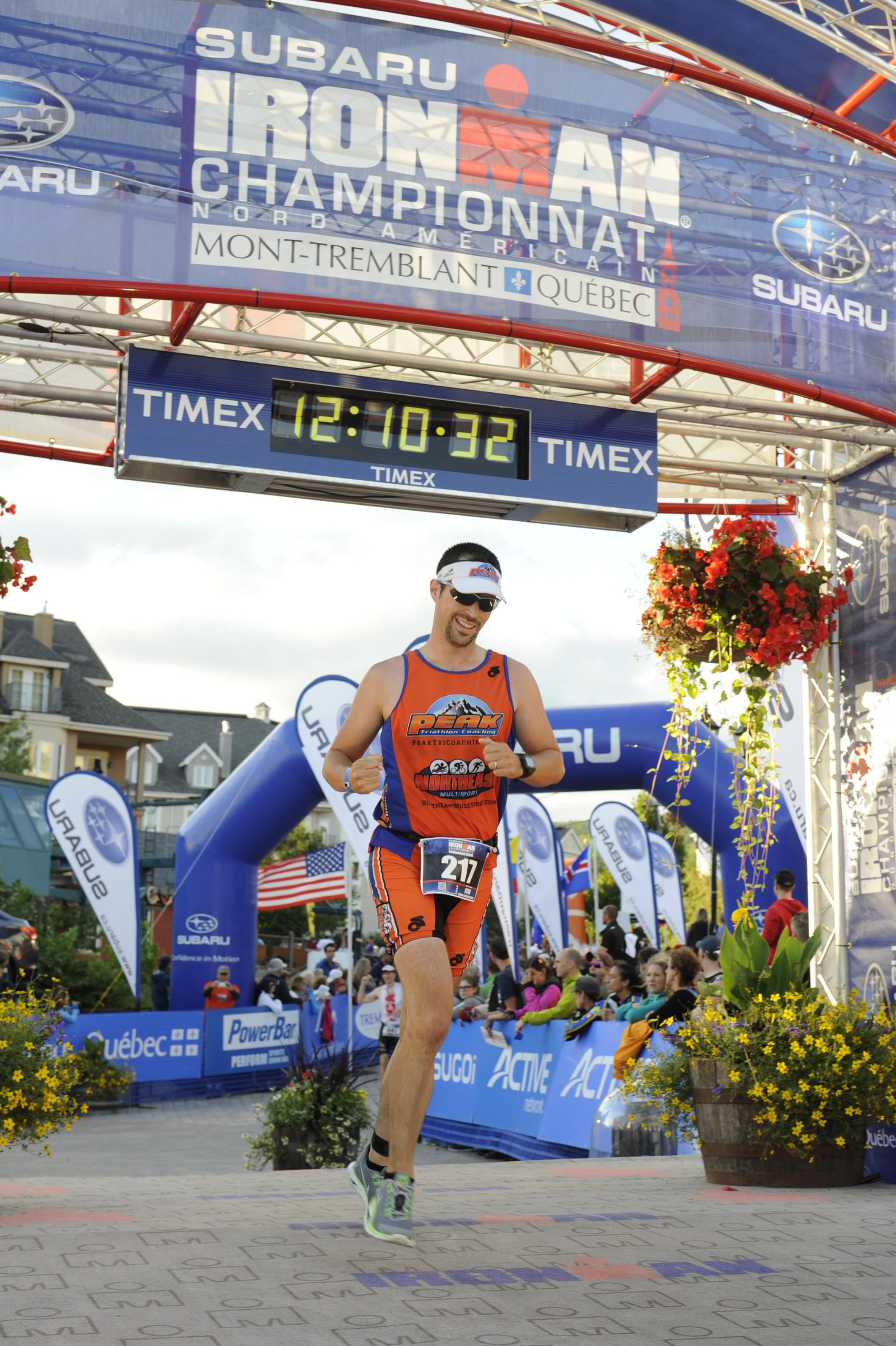 Ryan finishing his first Ironman
